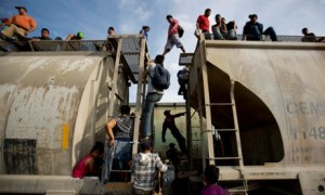 Migrants travel aboard the notoriously dangerous train known as La Bestia in Mexico. Photo: Eduardo Verdugo, Associated Press.