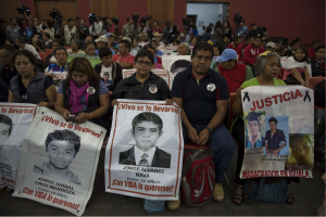Family members and friends of missing Ayotzinapa students wait for an international panel of experts to presents its findings. Source: New York Times