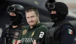 "Mexican federal police escort Edgar ""La Barbie"" Valdez in Mexico City on August 31, 2010. Source: Reuters. ""Mexico Extradites Alleged Drug Lord 'La Barbie' to U.S, Newsweek. September 30, 2015."