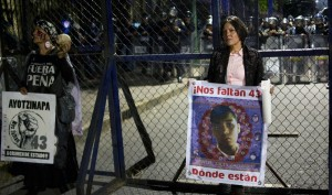 Family members demand justice and answers for 43 missing students.