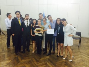 The UNAM team holds their 2nd place trophy in the international moot court competition.