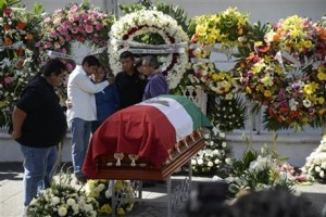 Mayor Gisela Mota's body was laid to rest after she was killed by members of Los Rojos gang on January 2, 2016. Photo: Associated Press, Tony Rivera.