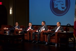 Octavio Rodríguez moderates panel on improving the administration of justice in Mexico. Panelists include Ray Allen Gattinella, Judge Luciano Angulo, and Robert Ciaffa.