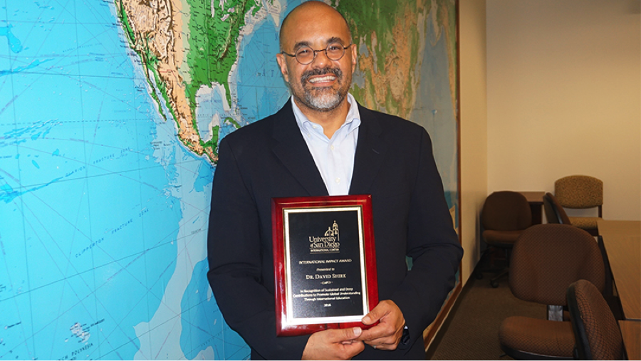 Dr. Shirk receives the 2016 International Impact Award. Source: USD News Center