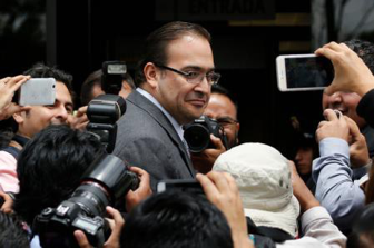 Javier Duarte, some months before he fled Mexico, standing outside of PRG headquarters in Mexico City. Source: The New York Times