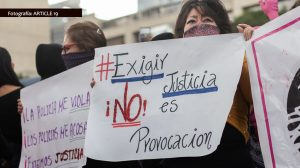Woman holds sign at protest